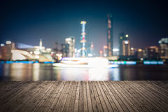 Abstract cityscape background with wooden floor at night Stock Photos