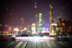 Abstract cityscape background with wooden floor at night. Royalty Free Stock Photos