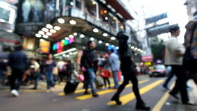 Abstract cityscape blurred background. Hong Kong. Abstract cityscape blurred background. Unrecognizable people walking on crosswalk in crowded city street with stock video footage