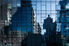 Abstract cityscape reflections in windows on a modern skyscraper stock photos
