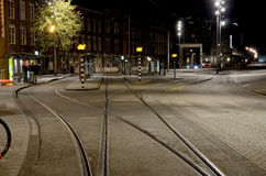 Abstract cityscape with tram tracks on the road in Amsterdam, Ne Royalty Free Stock Photo