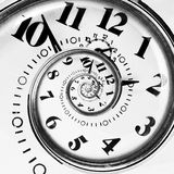 Abstract clock to infinity. Abstract clock spiraling to infinity Stock Images