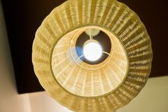 Abstract close up from bottom of weave lamp Asian style hanging on ceiling. Show texture of weave Royalty Free Stock Photos