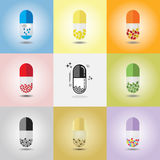 Abstract close up of colorful and conceptual vertical single capsules set Stock Photo