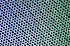 Holes in Metal Macro Background. Stock Photography
