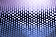 Holes in Metal Macro Background. Royalty Free Stock Images
