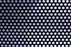 Holes in Metal Macro Background. Stock Image