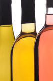 Abstract Close up of Three Wine Bottles Royalty Free Stock Images
