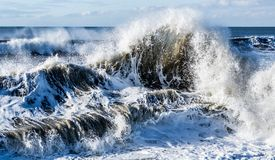 Ocean sea water crashing tsunami wave. Abstract closeup big large crashing stormy ocean tsunami water wave stock images