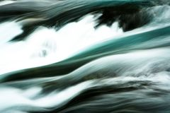 Abstract Closeup of McKenzie River Flow in Central Oregon. Abstract closeup of McKenzie River flow in the forests of Cascade Mountains in Central Oregon royalty free stock photos