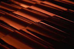 Abstract closeup metal profile roof-tile at sunset. Royalty Free Stock Image
