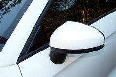 Abstract Closeup Side View of Rear-view Mirror And Vehicle Stock Photo