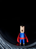 Abstract clothespin super hero in tube. Leadership Stock Photography