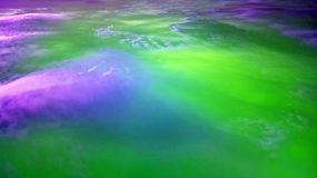 Abstract clouds in green purple. Abstract cloud background in purple and green with copy space Royalty Free Stock Photography