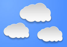 Abstract clouds on light blue background. Vector illustration Stock Photos