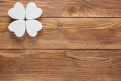 Abstract clover on wood background. Abstract white wooden clover or butterfly Stock Photo