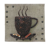 Abstract coffee beans mug concept over burlap canvas background Stock Images