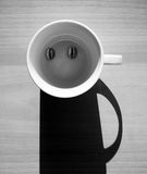 Abstract coffee concept, funny man character on table Royalty Free Stock Photography