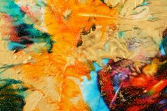Abstract color background. Acrylic paint with sparkles. Colorful blots. Marble texture stock photography