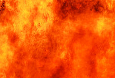 Abstract color background blur blazing fire flames. An out of control raging bushfire with the fires leaping and dancing, twisting and turning and spreading at a Stock Photo
