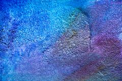 Abstract color painting on concrete block background. Blue,violet royalty free stock image