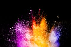 Abstract color powder explosion on black background. stock photos