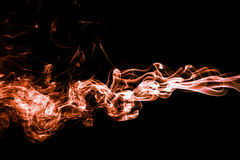 Abstract color smoke on black background, orange smoke backgroun. D,orange ink background,orange smoke,Orange Smoke Abstract Wallpaper or Background ,fire and Royalty Free Stock Photos