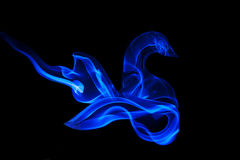 Abstract color smoke. Multi-colored streaming smoke on a white background Royalty Free Stock Image
