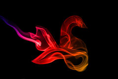 Abstract color smoke. Multi-colored streaming smoke on a white background Royalty Free Stock Photo