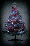 Abstract color toned christmas tree with snowflakes Stock Images