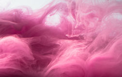 Abstract colored background. Pink smoke, ink in water, the patterns of the universe. Abstract movement, frozen. Multicolor flow of paint. Horizontal photo with stock image