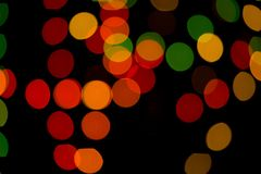 Abstract colored bokeh textures. Colored bokeh textures - abstract photo on the black background for adding and editing as the background layer in the multiply royalty free stock images