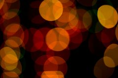 Abstract colored bokeh textures. Colored bokeh textures - abstract photo on the black background for adding and editing as the background layer in the multiply royalty free stock photography
