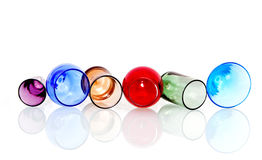 Abstract colored circles with glasses. Abstract image of colored circles with crystal glasses and reflection on white background Royalty Free Stock Photo