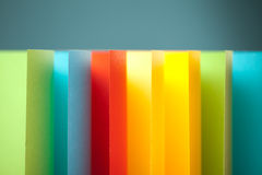 Abstract colored paper on blue background Royalty Free Stock Photos