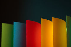 Abstract colored paper on grey background royalty free stock image