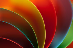 Abstract colored paper on orange background Stock Photos