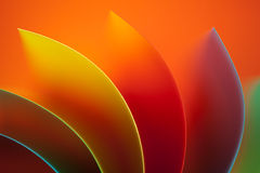 Abstract colored paper  on orange background Royalty Free Stock Photo