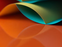 Abstract colored paper on orange background Royalty Free Stock Images