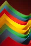 Abstract colored paper structure on red background Stock Photo