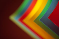 Abstract colored paper structure on red background Royalty Free Stock Image