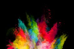 Abstract colored powder explosion isolated on black background. Royalty Free Stock Photos