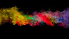 Abstract colored powder explosion isolated on black background. Stock Photos