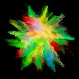 Abstract colored powder explosion isolated on black background. Stock Photography