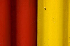 Abstract colored red and yellow iron metal Stock Photography