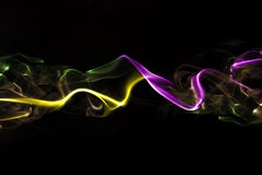 Abstract colored smoke. On a black background Stock Images