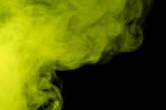 Abstract colored smoke hookah on a black background. Royalty Free Stock Image