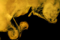 Abstract colored smoke hookah on a black background. Stock Photo