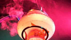 Abstract colored smoke hookah on a black stock video footage