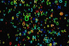 Abstract colorful alphabet fly on black background Stock Images